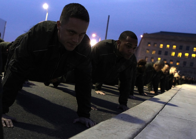 Marines from Headquarters Marine Corps finish their last set of pushups before the Commandant and Sergeant Major of the Marine Corps 3rd Annual Marine Corps Birthday Run Nov. 10. Marines ran from the Pentagon to the Marine Corps War Memorial, where they stopped to sing the Marines Hymn.