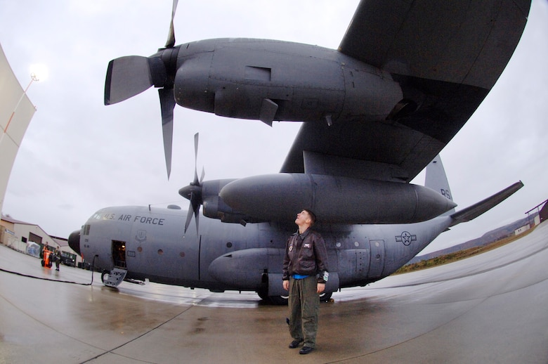 Capt. Tyler Robertson performs a walk around inspection prior to engine start up before piloting the last E-model C-130 Hercules Nov. 2, 2009, from Ramstein Air Base, Germany, to Powidz Air Base, Poland. (Defense Department photo/Master Sgt. Scott Wagers)