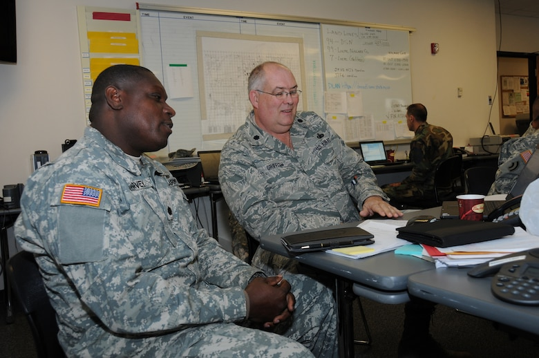 Lt. Col. Elvis Harvey, VING, shadows Lt. Col Barry Griffith during the week long Vigilant Guard exercise. Col. Harvey traveled 1900 miles from the Virgin Islands to observe the exercise. The VING is slated to host a Vigilant Guard in 2014.