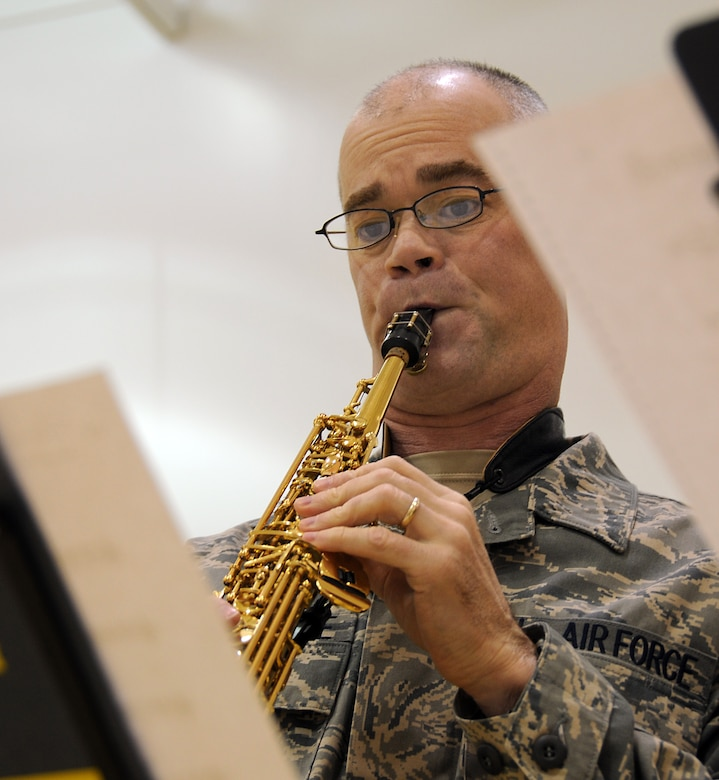 Tech. Sgt. Mike Van Arsdale, a member of the U.S. Air Force Band of the Pacific, plays a Christmas tune at St. George School on Nov. 7, 2009. U.S. Air Force photo by 1st Lt. John Callahan.