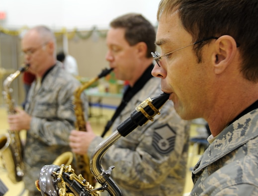 The Arctic Sax Quartet, part of the Air Force Band of the Pacific, performs at the St. George School on Nov. 7, 2009. In the foreground is Master Sgt. Brian Jenner on baritone sax; behind him are Tech. Sgt. Mike Van Arsdale (left) on tenor sax, and Master Sgt. Lon Throop on alto sax. U.S. Air Force photo by 1st Lt. John Callahan.