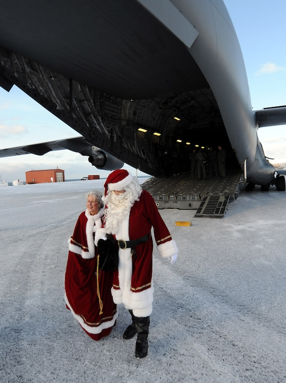 Santa and Mrs. Santa disembark at the St. George airstrip on Nov. 7, 2009. A close partnership between the Alaska Air National Guard's 249th Airlift Squadron and the U.S. Air Force's 517 Airlift Squadron made possible the first use of a C-17 Globemaster III in the 53-year history of Operation Santa Claus. U.S. Air Force photo by 1st Lt. John Callahan.