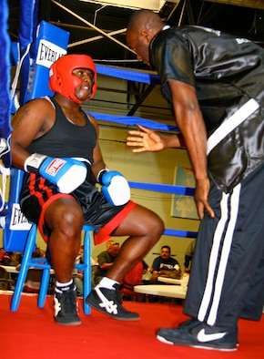 Tinker assistant boxing coach Torraine Smith gives fighter Michael Baker some tips between rounds during the Nov. 7 bout in Tulsa. Baker, an Army Soldier stationed at Fort Sill, Okla., bested his opponent in his second ever USA Boxing league bout. (Air Force photo by John Stuart)