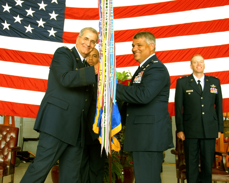 Col. Tony Carrelli, 111th Maintenance Group commander, receives the guideon from Maj. Gen. Stephen M. Sischo, Deputy Adjutant General-Air and Commander of the Pa. Air National Guard and assumes command of the 111th Fighter Wing during a change of command ceremony held Aug. 2 at Willow Grove Air Reserve Station, Pa.