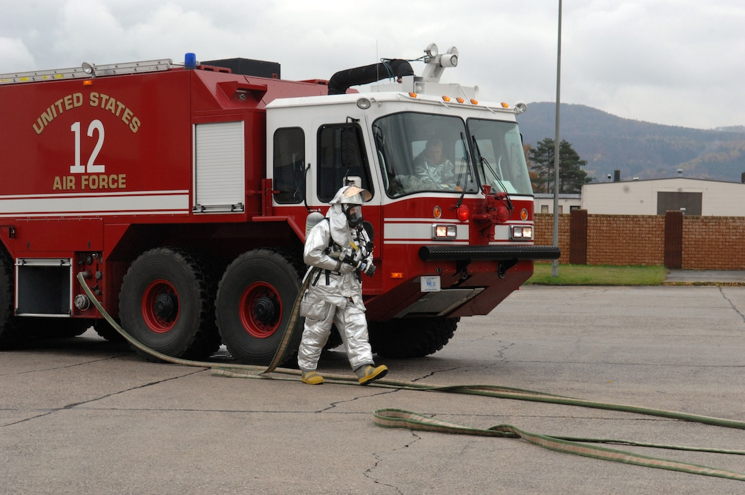U.S. Air Force fire fighters from Landstuhl Air Base and Vogelweh Military Station work together during an exercise on Ramstein Air Base, Germany Nov. 10, 2009. The fire fighters participated in timed simulated fire scenarios to maintain proficiency and qualifications. (U.S.  Air Force Airman 1st Class Brittany Perry)