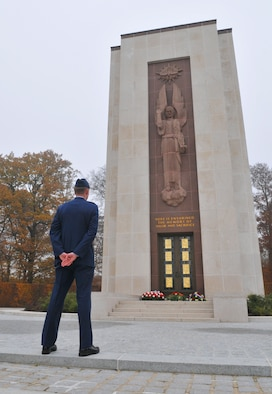 SPANGDAHLEM AIR BASE, Germany – Capt. Gary Moore, 52nd Operations Group, stands at parade rest in front of the memorial chapel to pay respects to fallen soldiers at the Luxembourg American Cemetery and Memorial in Luxembourg City Nov. 11. In the center of the cemetery is a memorial chapel where visitors can enter to pay respects to members of the armed forces. The 50.5 acre cemetery is one of 14 American cemeteries established overseas after World War II and contains remains of more than 5,000 American servicemembers who died during the World War II. (U.S. Air Force photo/Airman 1st Class Nick Wilson)