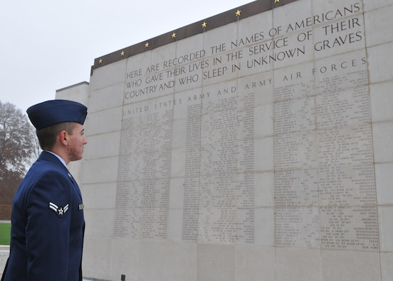 SPANGDAHLEM AIR BASE, Germany -- Airman 1st Class Michael D. Kimball, 52nd Operations Support Squadron, looks at the names of Americans who died in service of their country at the Luxembourg American Cemetery and Memorial in Luxembourg City Nov. 11. More than 5,000 American servicemembers fighting in World War II now rest at the 50.5 acre cemetery, which is one of 14 American cemeteries established overseas after World War II. (U.S. Air Force photo/Airman 1st Class Nick Wilson)