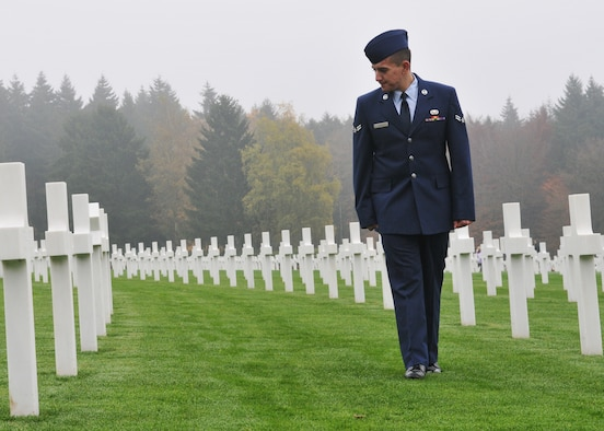SPANGDAHLEM AIR BASE, Germany -- Airman 1st Class Michael D. Kimball, 52nd Operations Support Squadron, looks at graves of fallen World War II soldiers at the Luxembourg-American Cemetery and Memorial in Luxembourg City, Nov. 11. More than 5,000 American servicemembers from World War II now rest at the 50.5 acre cemetery, which is one of 14 American cemeteries established overseas after World War II. (U.S. Air Force photo/Airman 1st Class Nick Wilson)