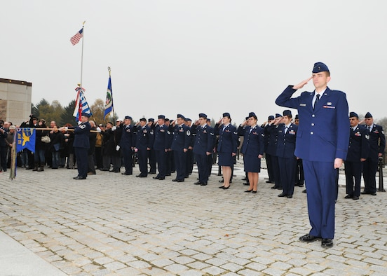 SPANGDAHLEM AIR BASE, Germany -- Members of the 52nd Fighter Wing salute during the national anthem at the annual Veterans Day ceremony at the Luxembourg American Cemetery and Memorial in Luxembourg City Nov. 11. More than 5,000 American servicemembers from World War II now rest at the 50.5 acre cemetery, which is one of 14 American cemeteries established overseas after World War II. (U.S. Air Force photo/Airman 1st Class Nick Wilson)