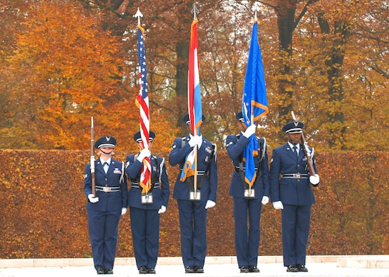 SPANGDAHLEM AIR BASE, Germany -- The 702nd Munitions Support Squadron Color Guard stands at attention before posting the colors for the annual Veterans Day ceremony at the Luxembourg American Cemetery and Memorial in Luxembourg City Nov. 11.  The 50.5 acre cemetery, which is one of 14 American cemeteries established overseas after World War II, contains the remains of more than 5,000 American servicemembers who died fighting in World War II. (U.S. Air Force photo/Airman 1st Class Nick Wilson)