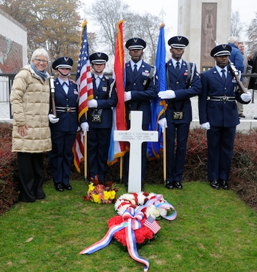 SPANGDAHLEM AIR BASE, Germany -- The 702nd Munitions Support Squadron Color Guard from Buechel Air Base, Germany, stands at attention in front of the grave of Gen. George S. Patton Jr., Third Army commander during World War II, with Helen Patton-Plusczyk, General Patton's granddaughter, during the annual Veterans Day ceremony at the Luxembourg American Cemetery and Memorial in Luxembourg City Nov. 11. The 50.5 acre cemetery, which is one of 14 American cemeteries established overseas after World War II, contains the remains of more than 5,000 American servicemembers who died during World War II. (U.S. Air Force photo/Maj. Jillian Torango)
