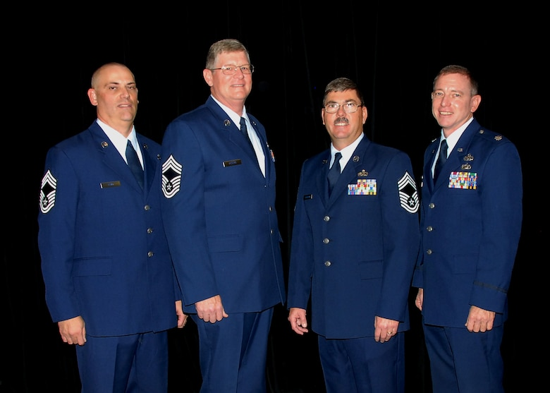 Col (Sel) Mark Beck, 131st Bomb Wing Maintenance Group Commander, stands proudly with newly promoted 131st Bomb Wing Chief Master Sergeants (l to r) :Mark Funk, Dan Peters, and Ken Slabaugh during a ceremony held at Whiteman AFB, November 14, 2009.  (Air Force Photo by Master Sergeant Mary-Dale Amison