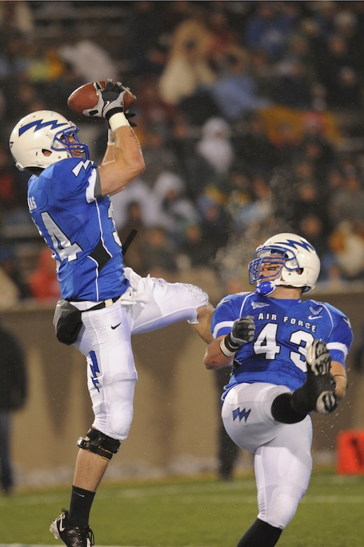 Air Force defensive back Chris Thomas intercepts a pass intended for UNLV wide receiver Ryan Wolfe in the end zone during the Falcons-Rebels game at Falcon Stadium Nov. 14, 2009. The interception was the second this season for Thomas, a senior from Westerville, Ohio, and the fifth pick of his career. (U.S. Air Force photo/Rachel Boettcher)