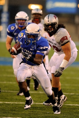 Air Force sophomore running back Asher Clark runs 24 yards for a touchdown against UNLV at Falcon Stadium Nov. 14, 2009. Clark, a native of Lawrenceville, Ga., had a career-high 160 rushing yards and three touchdowns in Air Force's 45-17 victory. (U.S. Air Force photo/Bill Evans)