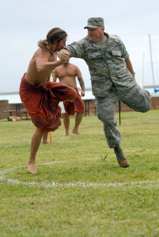 HICKAM AIR FORCE BASE, Hawaii -- Staff Sgt. Mike Meares, 15th Airlift Wing public affairs, competes in the Hakamoa (one legged wrestling) event against a local competitor during the Makahiki Festival here, Nov. 14. For more than two-thousand years, the significance of Lono and his contributions to the beliefs and practices of the early Hawaiian people, influenced the celebration of events held during the Makahiki Festival throughout the Hawaiian Islands. Since Lono was the embodiment of all the characteristics of peace and welfare, all warfare was strictly forbidden during the time of the Makahiki. Since Lono represented the spiritual life-force that came out of all agricultural efforts, much feasting of every kind was done during the four months of the Makahiki. This focus on health and welfare made games of skill that tested a healthy body and mind a focal point of the Makahiki games. (U.S. Air Force photo/Senior Airman Gustavo Gonzalez)