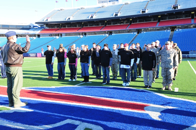NIAGARA FALLS AIR RESERVE STATION, N.Y. -- The 914th Airlift Wing recruiting office holds a mass enlistment ceremony October 11 at Ralph Wilson Stadium, home of the National Football League Buffalo Bills, Orchard Park, N.Y.  The oath of enlistment is given by Col. Allan L. Swartzmiller, 914 AW commander. (U.S Air Force photo by Staff Sgt. Joseph McKee)
