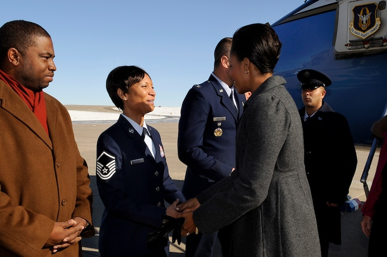 BUCKLEY AIR FORCE BASE, Colo. -- First Lady Michelle Obama is greeted by Master Sgt. Derinda Johnson, 460th Space Wing staff first sergeant, as she arrives at Buckley Air Force Base Nov. 16. (U.S. Air Force photo by Staff Sgt. Steve Czyz)