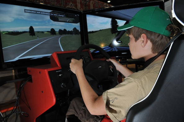 SPANGDAHLEM AIR BASE, Germany -- Alex Wrede, 11-year-old son of Maj. Valorie Wrede, 52nd Medical Operations Squadron, tests out a driving simulator at the Eifel Holiday Bazaar Nov. 13. The bazaar featured more than 100 booths ranging from driver simulators to European vendors selling handmade soaps, wine, jewelry, furniture, clothing and dishware to members of the 52nd Fighter Wing. (U.S. Air Force photo/Airman 1st Class Nick Wilson)