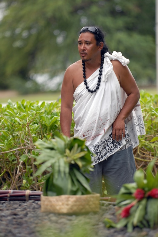 HICKAM AIR FORCE BASE, Hawaii -- Braven Canibog, chants an Oli, or a blessing, in the native Hawaiian language  at the Haleamau Halealoha Burial after the Makahiki Festival here, Nov. 14. The gifts were set on the burial to respect and honor the ancestors of Hawaiians who came before them. (U.S. Air Force photo/Senior Airman Gustavo Gonzalez)