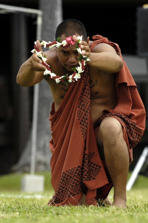 Kanoa Nelson offers a lei as an offering to Lono during the 7th Annual Kapuaikaula (Hickam) Makahiki (Thanksgiving) festival Nov. 14. Local Hawaiian and Hickam officials gathered at Hickam Harbor for the ancient ceremony and festival. The festival involved a ceremonial arrival in canoes, spiritual offerings, five skills competitions and a feast to end the day. According to history texts, the Makahiki was started to honor Lono, the Hawaiian guardian of agriculture, rain, health and peace. The offerings to Lono during the Makahiki were taken to the burial site. (DoD photo by U.S.  Air Force Tech Sgt. Cohen A. Young)
