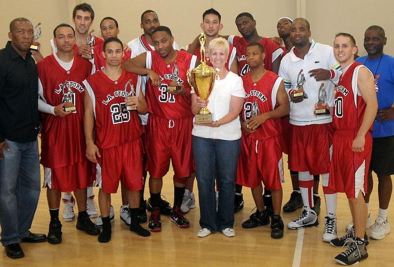 "Members of the LA Storm from Los Angeles Air Force Base stand with Col. Anita Latin (center), 61st Air Base Wing commander, after winning the championship trophy, Nov. 8. Los Angeles AFB sponsored the 2009 Veterans Day ""SoCal Shootout"" Basketball Tournament on Nov. 7 and 8, which included participation from Luke AFB, Travis AFB, Vandenberg AFB, and Edwards AFB. The LA Storm won the championship title with an 80 to 77 victory over Travis. (Photo by Atiba Copeland)"
