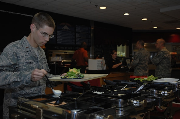 WHITEMAN AIR FORCE BASE Mo. – 2nd Lt. Benjamin Coffman, 509th Contracting Squadron member, enjoys the buffet offered at Missions End Nov  17.  Missions End offers a variety of catered events during large and small, from wedding receptions to Sweet 16 birthday parties and military functions such as Airmen Leadership School graduations.(U.S. Air Force Photo/ Senior Airman Jessica Mae Snow) (Released)