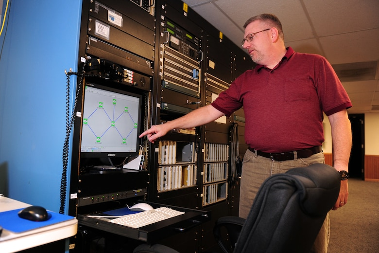 OFFUTT AIR FORCE BASE, Neb. - Dave Clingerman, a telecommunications specialist with the 55th Strategic Communications Squadron, explains how monitors the antennas for the Elkhorn and Scribner Communication Sites Nov. 5 from a detached facility located near Elkhorn, Neb. The communication sites support a wide variety of missions from executive levels of government to the National Aeronautics and Space Administration. U.S. Air Force photo by Josh Plueger