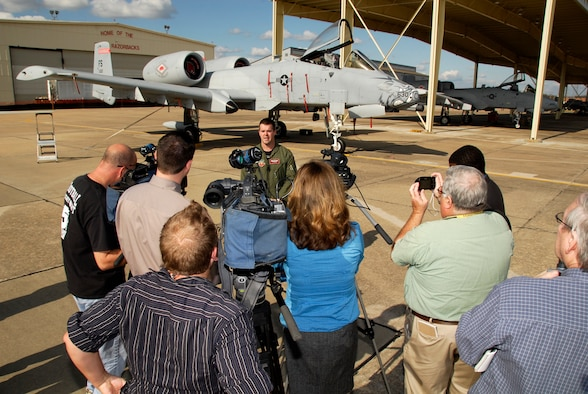 """Maj. Jay Spohn, an A-10 Thunderbolt II """"Warthog"""" pilot with the 188th Fighter Wing Arkansas Air National Guard, based in Fort Smith, Ark., is interviewed by media at a press conference held at the 188th Nov. 10, 2009. Spohn was the only Air National Guard pilot to be selected to fly the F-35 Lightning II Joint Strike Fighter in the program's initial cadre. (U.S. Air Force photo by Senior Master Sgt. Dennis Brambl/188th Fighter Wing Public Affairs)"""