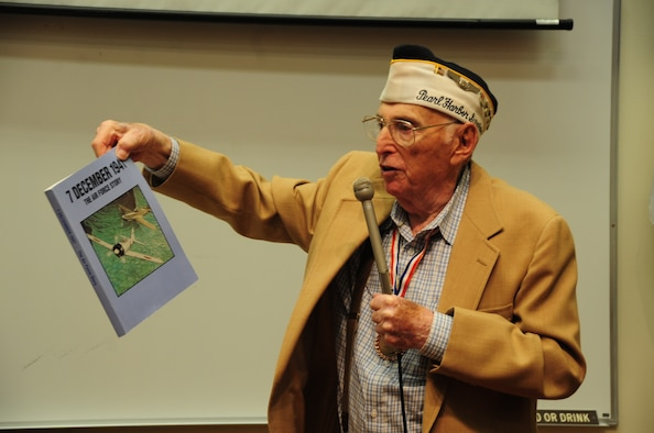 ELLSWORTH AFB, S.D.-- Stan Lieberman, survivor from the attack on Pearl Harbor, December 7, 1941, talks about his experiences during the attack and shows audience a book detailing the event that cost more than 2,000 American lives, Nov 10.  Stan Lieberman joined the U.S. Army Air Corps in 1940 as an aerial photographer. (U.S. Air Force photo/Airman 1st Class Anthony Sanchelli)