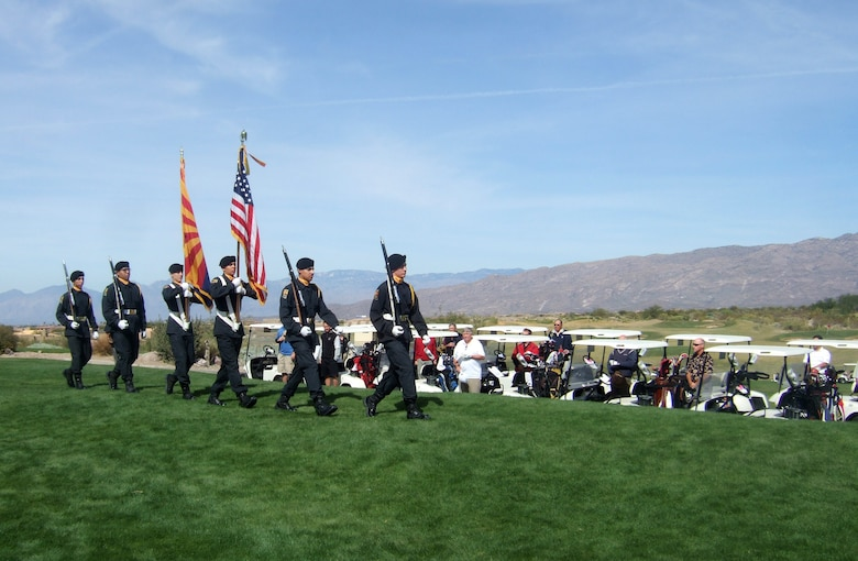 The Project Challenge Color Guard posts the colors at the 162nd Fighter Wing Minuteman Committee Golf Tournament at Del Lago Golf Course in Vail, Ariz., Oct. 30. Project Challenge was one of four non-profit organizations that benefited from the $12,500 generated by the tournament. (Courtesy photo by CeCe Perry, Wright Flight)