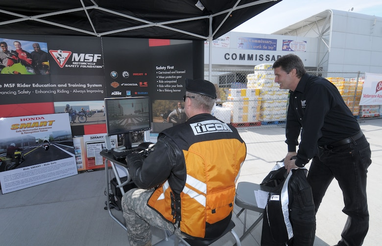 A participant sits immersed in an interactive motorcycle simulator created by the Motorcycle Safety Foundation, Nov. 9. Los Angeles Air Force Base sponsored the 2009 Motorcycle Safety Awareness Day which included vendors, a stunt show and  other attractions. (Photo by Lou Hernandez)