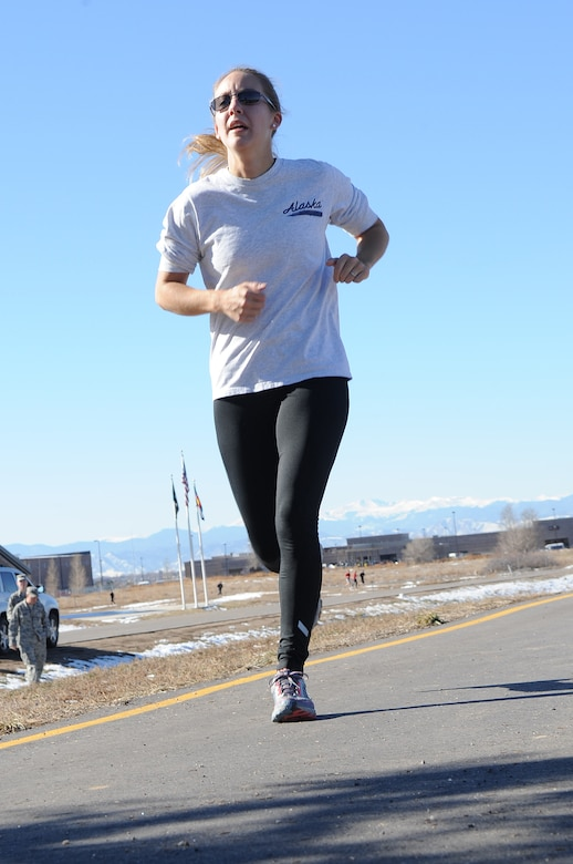 BUCKLEY AIR FORCE BASE, Colo. -- Staff Sgt. Lauren Twigg hurries toward the finish line during the Turkey Trot Nov. 18. First-place winners in the trot were awarded a free turkey. (U.S. Air Force photo by Airman First Class Marcy Glass)