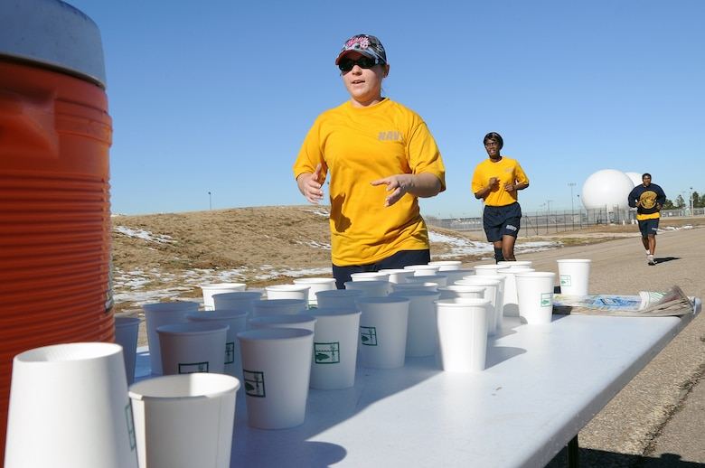 BUCKLEY AIR FORCE BASE, Colo. -- Navy servicemembers stop to get a drink of water during the annual Turkey Trot Nov. 18. A large number of servicemembers and civilians particpate in the Annual Turkey Trot. (U.S. Air Force photo by Airman First Class Marcy Glass)