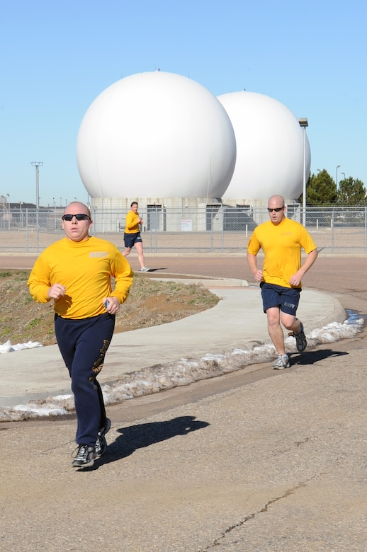 BUCKLEY AIR FORCE BASE, Colo. -- Team Buckley runners speed toward the finish line during the annual Turkey Trot Nov. 18. First-place finishers were awarded a free turkey. (U.S. Air Force photo by Airman First Class Marcy Glass)