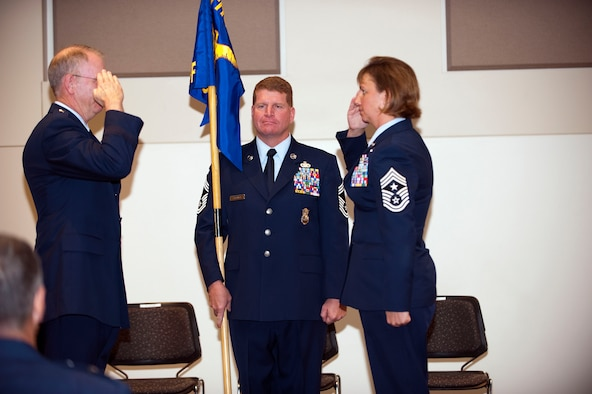 Command Chief Master Sgt. Annadele F. Kenderes accepts authority as Colorado?s newest state command chief master sergeant from Colorado Air National Guard Commander Brig. Gen. Bill Hudson during a ceremony at Buckley Air Force Base, Colo., Oct 4, 2009. (U.S. Air Force photo by Master Sgt. John Nimmo, Sr.) (Released)