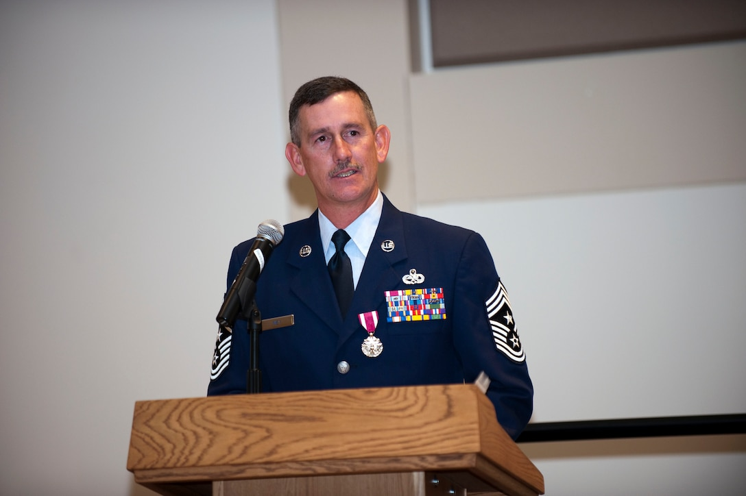 Command Chief Master Sgt. Bruce A. Mey gives his parting words after relinquishing the title of Colorado Air National Guard state command chief master sergeant to Command Chief Master Sgt. Annadele F. Kenderes during a ceremony at Buckley Air Force Base, Colo., Oct 4, 2009. (U.S. Air Force photo by Master Sgt. John Nimmo, Sr.) (Released)