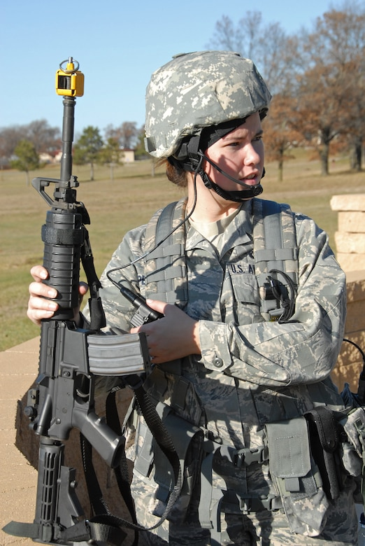 Airman 1st Class Angela Peterson, fire team member with the 115th Fighter Wing Security Forces performs a functional check of her radio equipment prior to beginning a combat training exercise at Volk Field, Air National Guard Base, Camp Douglas, Wis. Nov. 7, 2009.The Madison, Wis. based 115th Security Forces Squadron engaged in a variety of combat training exercises as part of their November Unit Training Assembly. (U.S. Air Force photo by Master Sgt. Paul Gorman)