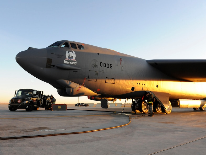 MINOT AIR FORCE BASE, N.D. -- A 23rd Bomb Squadron B-52H Stratofortress is refueled by members of the 5th Logistics Readiness Squadron fuels flight on the mass parking area here Nov. 17. Refueling Minot's muscle is just one of many mission essential tasks performed by 5th LRS Airmen. (U.S. Air Force photo by Senior Airman Matthew Smith)