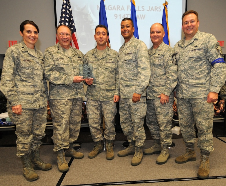 NIAGARA FALLS AIR RESERVE STATION, N.Y. -- The 914th Airlift Wing received first place as the top Get One Now program in the Air Force Reserve.  This award was presented October 22 in Savannah, Georgia during the Air Force Reserve Recruiting Command's field training exercise awards banquet.  Pictured from left to right:  Col. Patricia Jarmuz, 914th Aeromedical Staging Squadron commander; Lt. Gen. Charles Stenner Jr., Commander of Air Force Reserve Command; Senior Master Sgt. Pasquale Muoio, 914th Airlift Wing senior recruiter; Col. Joseph Wilburn, Air Force Reserve Recruiting commander; Chief Master Sgt. Dwight Badgett, Air Force Reserve Command Chief Master Sergeant; Chief Master Sgt. Robert Starkey, Air Force Reserve Recruiting Service Manager.  (U.S. Air Force photo)