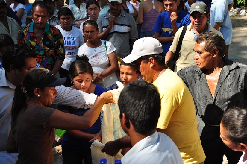 ILOPANGO, El Salvador - Community leaders distribute food and water to the villagers of El Sauce, El Salvador Nov. 17. A Civil Affairs team from Special Operations Command South, based out of Homestead, Florida, provided vital aid to the small village of El Sauce by dropping off more than 5,000 total pounds of food and water Nov. 17 and 18. The area was so badly damaged by the floods that villagers had to hand-carry the 5,000 pounds of food and water almost a quarter of a mile back to the village (U.S. Air Force photo/Staff Sgt. Chad Thompson).