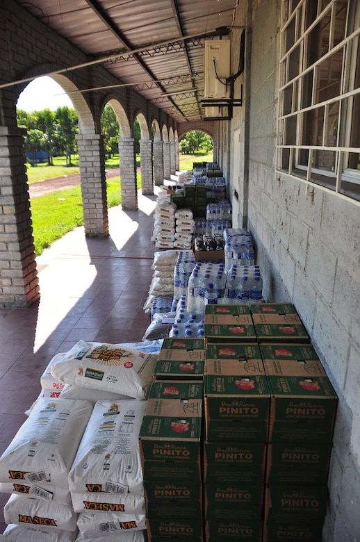 ILOPANGO, El Salvador - Thousands of pounds of food and water sits and waits to be distributed to the small town of El Sauce Nov. 17 near Ilopango International Airport. A Civil Affairs team from Special Operations Command South, based out of Homestead, Florida, provided vital aid to the small village of El Sauce by dropping off more than 5,000 total pounds of food and water Nov. 17 and 18. This has been a combined effort by Salvadoran government and military, the people of El Sauce, the U.S. Agency for International Development, or USAID, Civil Affairs and Joint Task Force-Bravo (U.S. Air Force photo/Staff Sgt. Chad Thompson).