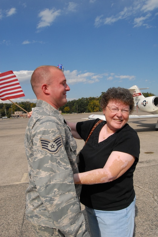 Staff Sgt. Steven Sevigny, 103rd Maintenance Squadron, gets a warm welcome from his mom, Judy Sevigny, on the flightline at Bradley Air National Guard Base , East Granby, Conn. Oct. 4, 2009.  Sevigny had returned home after deployment to Southwest Asia in support of overseas contingency operations.  (U.S. Air Force Photo by Capt. Jefferson S. Heiland)