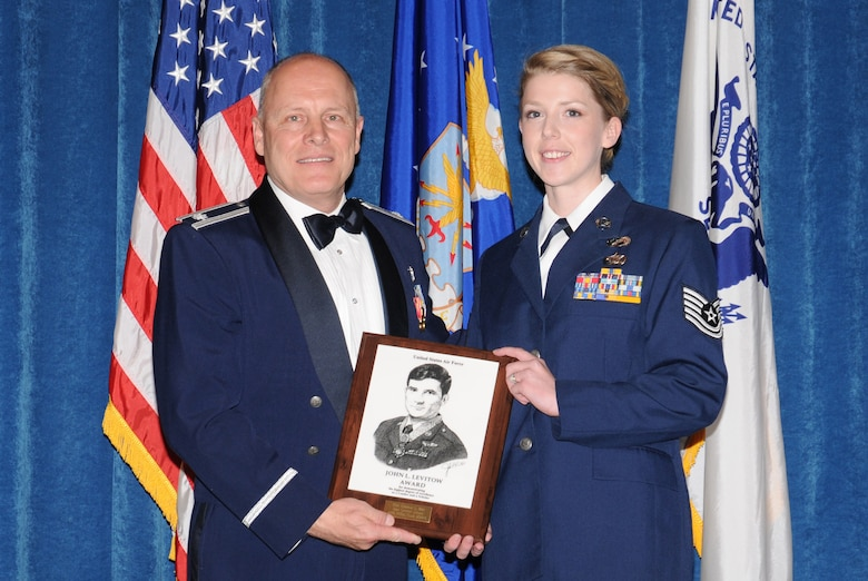 McGHEE TYSON AIR NATIONAL GUARD BASE, Tenn. -- Tech. Sgt. Rebekah L. Birt, right, a personnelist with the 125th Special Tactics Squadron, Oregon Air National Guard, receives the John L. Levitow Honor Award for NCO Academy Class 10-1 from Lt. Col. Stan Giles, left, at The I.G. Brown Air National Guard Training and Education Center here, Nov. 19, 2009.  The John L. Levitow Award is the highest honor awarded a graduate of any Air Force enlisted professional military education course.  (U.S. Air Force photo by Master Sgt. Kurt Skoglund/Released)