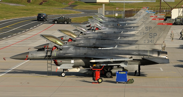 SPANGDAHLEM AIR BASE, Germany -- F-16 Fighting Falcons from the 22nd Fighter Squadron line a ramp Nov. 20 here. The 22nd and 81st Fighter Squadrons participated in Operation Saber Crown 10-02, which tested the 52nd Fighter Wing's capabilities to operate during a real-world contingency. (U.S. Air Force photo/Airman 1st Class Nathanael Callon)