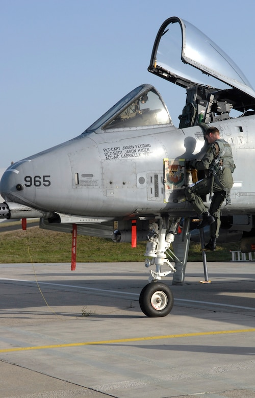 SPANGDHALEM AIR BASE, Germany – Capt. Gary Moore, 52nd Operations Group executive officer and A-10 Thunderbolt II pilot, exits his aircraft after an initial post-flight inspection Nov. 20. Airmen then backed the A-10 into Hardened Aircraft Shelter 2 to conduct a more thorough inspection and aircraft regeneration. The A-10 was part of a six-ship flying formation that flew to a simulated deployed location during Operation Saber Crown 10-02. (U.S. Air Force photo/Senior Airman Kali L. Gradishar)