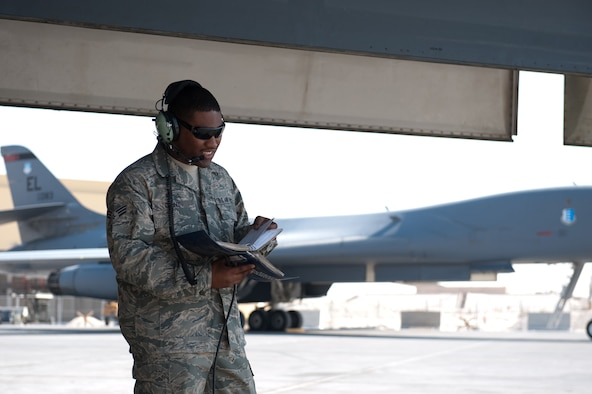 Senior Airman William Hunt, 37th Aircraft Maintenance Unit crew chief, reviews technical orders while refueling a B-1B Lancer, Nov. 15, in Southwest Asia. The 37 AMU works to keep the B-1 operational and safe for missions in the U.S. Central Command area of responsibility. Airman Hunt is deployed from Ellsworth Air Force Base, S.D. in support of operations Iraqi and Enduring Freedom. (U.S. Air Force photo/Staff Sgt. Robert Barney)