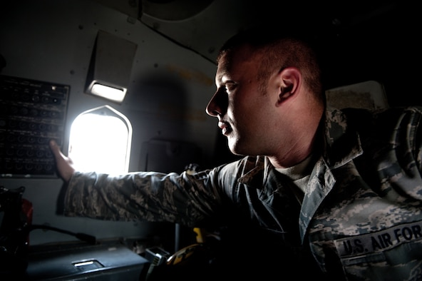 Staff Sgt. John Termun, 37th Aircraft Maintenance Unit crew chief, checks a circuit panel aboard a B-1B Lancer, Nov. 15, in Southwest Asia. The 37 AMU works to keep the B-1 operational and safe for missions in the U.S. Central Command area of responsibility. Sergeant Termun is deployed from Ellsworth Air Force Base, S.D. in support of operations Iraqi and Enduring Freedom. (U.S. Air Force photo/Staff Sgt. Robert Barney)