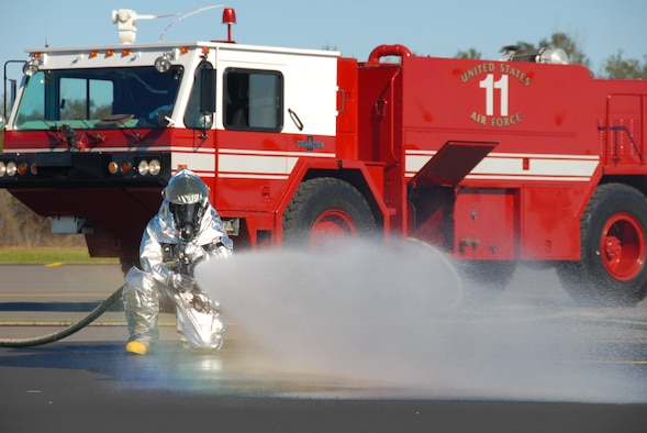 A Maxwell firefighter hoses down the runway at the Prattville airport. (U.S. Air Force photo/Jamie Pitcher)