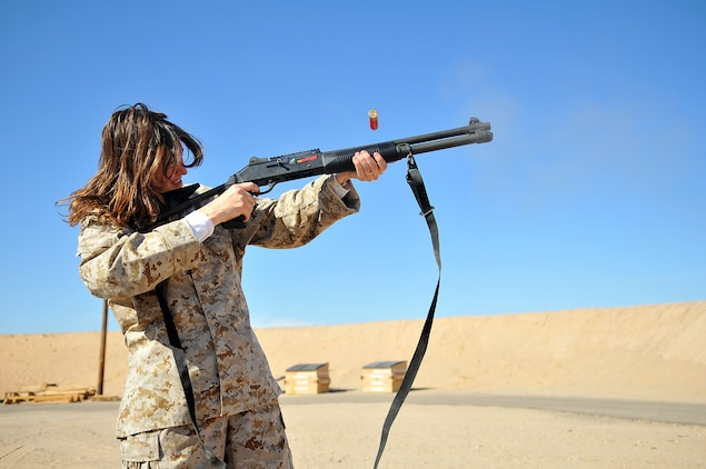 Laura Nerad, Marine Aircraft Group 13 spouse, fires an M-1014 shotgun at the rifle range of the Marine Corps Air Station in Yuma, Ariz., during Marine Attack Squadron 311's Jane Wayne day Nov. 20, 2009. Jane Wayne days allow family members to experience the cornerstones of Marine training and conditioning, such as physical training and weapons handling. The family members got a taste of the Marine Corps Martial Arts Program, weapons training, obstacle course, combat fitness test and the station's flight simulator during the squadron's Jane Wayne day.