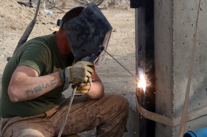 Cpl. Malcolm S. Leachman, a basic metal worker for Alpha Company, 2nd Combat Engineer Battalion, is strengthening the an entry gate at Forward Operating Base Delhi, Nov. 22. This work was a part of a re-supply mission to forward operating bases. 2nd Battalion, 2nd Marine Regiment, occupies FOB Delhi conducting counter insurgency operations.